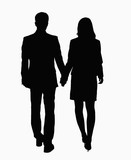 Silhouette of businessman and businesswoman holding hands.