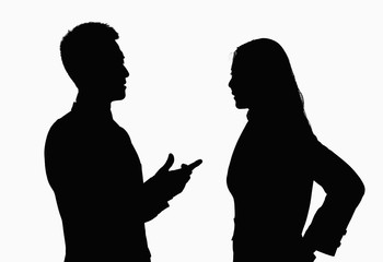 Silhouette of businessman and businesswoman talking.