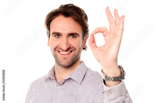 Smart man showing okay sign