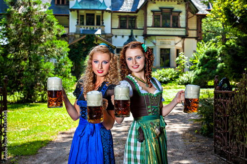 Two girls with Oktoberfest beer stein