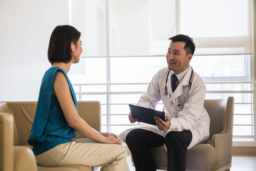 Doctor sitting down and consulting patient in the hospital