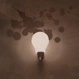 light bulb 3d on wrinkled splash paper