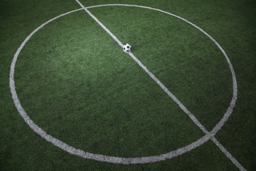 Soccer field with soccer ball on the line, high angle view
