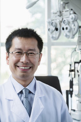 Portrait of smiling optometrist in his clinic