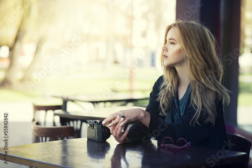 beautiful young girl resting in a cafe