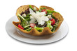 Vegetable salad in tortilla bowl shape with cheese