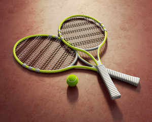 Isolated yellow tennis racquets with ball on clay court