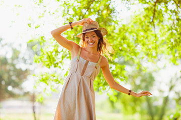 happy girl walking in the summer park
