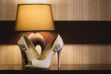 bride shoes near the lamp