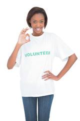 Pretty woman with volunteer tshirt making okay gesture