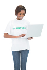 Happy volunteer woman using laptop