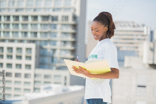Smiling altruist woman holding notebook