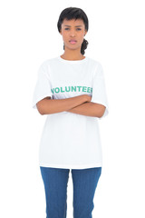 Depressed black haired volunteer posing with crossed arms