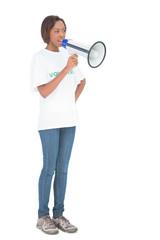 Serious woman shouting in megaphone