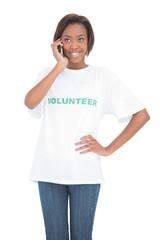 Cheerful pretty volunteer having a phone call