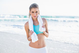 Relaxed sporty blonde in sportswear with towel around neck