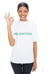 Smiling model wearing volunteer tshirt making okay gesture