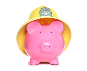 piggy bank wearing firemans hat