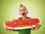punk boy eating a big slice of watermelon