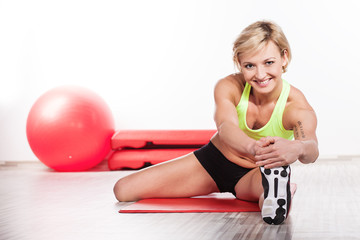 Smiling woman doing fitness exercise