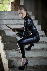woman in leather dress and combat knife