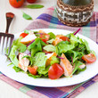 Delicious fresh salad with salmon, lettuce, cherry tomatoes and