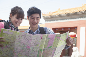 Young couple looking at map.