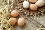 Brown eggs in a wicker plate and sackcloth