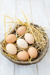 Brown eggs in a wicker basket