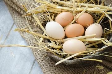 Brown hen eggs in a basket