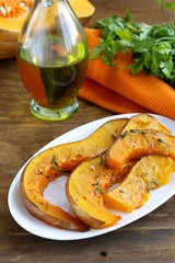 pumpkin baked with herbs and spices on a plate