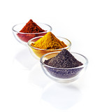 Colourful bowls of ground spice
