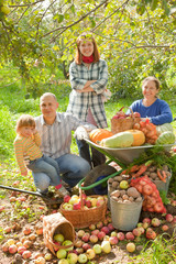 family with  harvest in garden