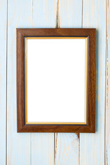 Wooden picture frame on a wooden blue background