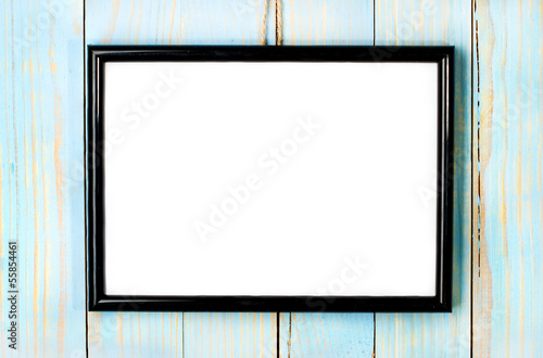photo frame on wooden blue background
