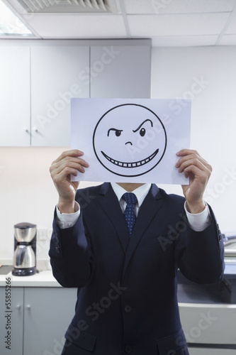 Businessman Holding Happy Face on Paper Over Face