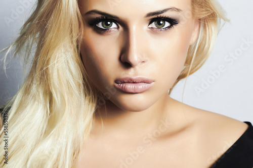 beautiful blond girl with green eyes.woman.professional make-up
