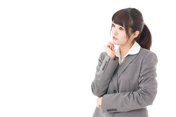 young businesswoman thinking on white background