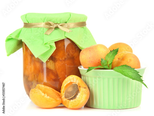 Apricot jam in glass jar and fresh apricots, isolated on white