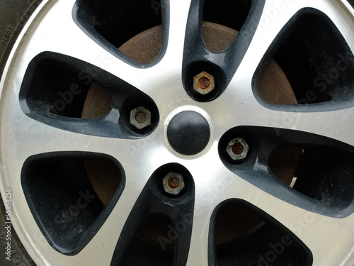Magnesium alloy wheel with rusty bolt