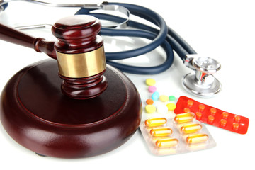 Medicine law concept. Gavel, stethoscope and pills isolated