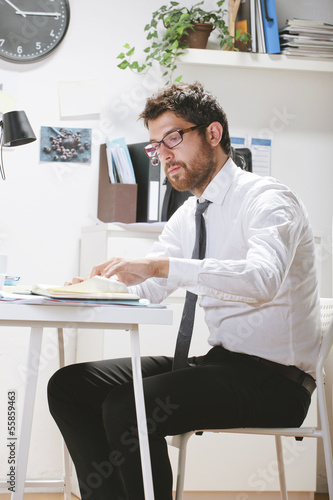 Young businessman working in office.