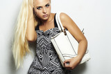fashion beautiful blond woman with handbag.shopping.long hair