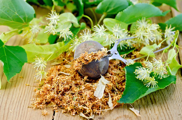 Herbal tea from dry linden flowers in a tea strainer