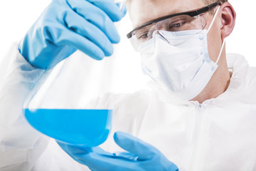 Scientist working in laboratory examining