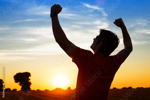 Sportsman with arms up celebrating success