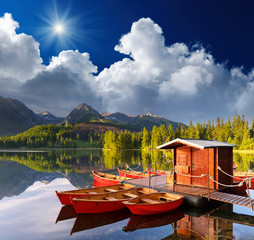 Red boat in a mountain lake
