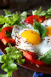 eggs with vegetables on the plate
