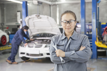 Proud Female Mechanic with Colleague