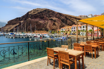 Chairs tables local restaurant in harbour, Madeira island
